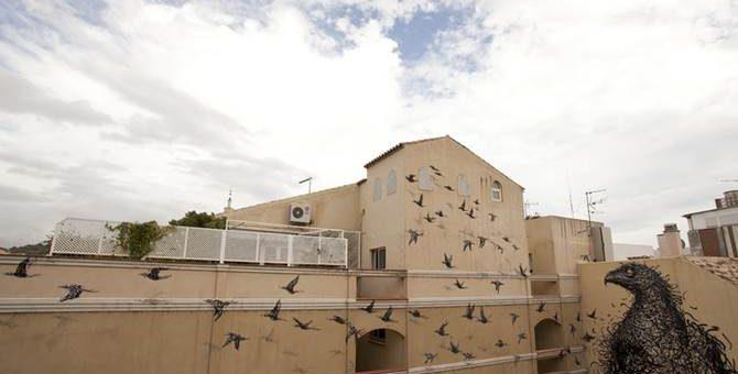 Граффити в Кейптауне уличного художника DALeast