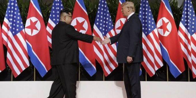 Первая встреча Трампа и Ким Чен Ына фото